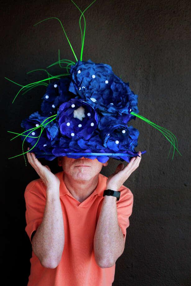 Easter bonnet designer mastermind extraordinaire Joe Mac models his blue bouquet creation. Photo: Mike Kepka, The Chronicle / ONLINE_YES