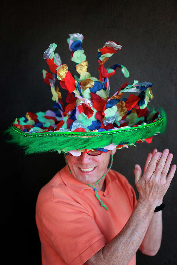 Easter bonnet designer mastermind extraordinaire Joe Mac models his cha cha cha creation. Photo: Mike Kepka, The Chronicle / ONLINE_YES