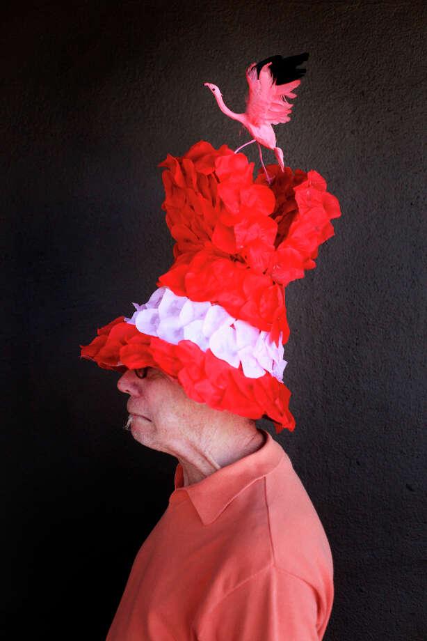 Easter bonnet designer mastermind extraordinaire Joe Mac models his flamingo creation. Photo: Mike Kepka, The Chronicle / ONLINE_YES