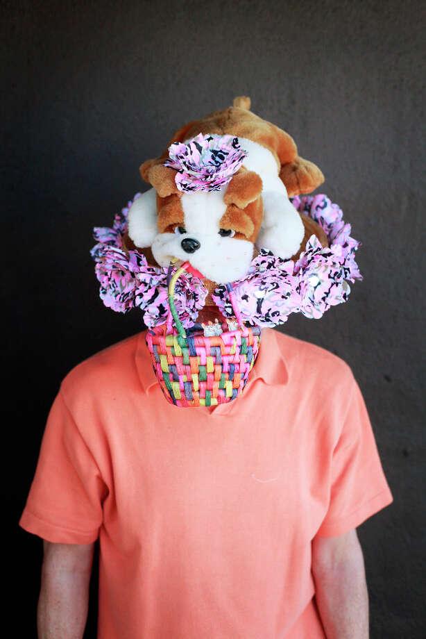 Easter bonnet designer mastermind extraordinaire Joe Mac models his Dog eat Dog creation. Photo: Mike Kepka, The Chronicle / ONLINE_YES