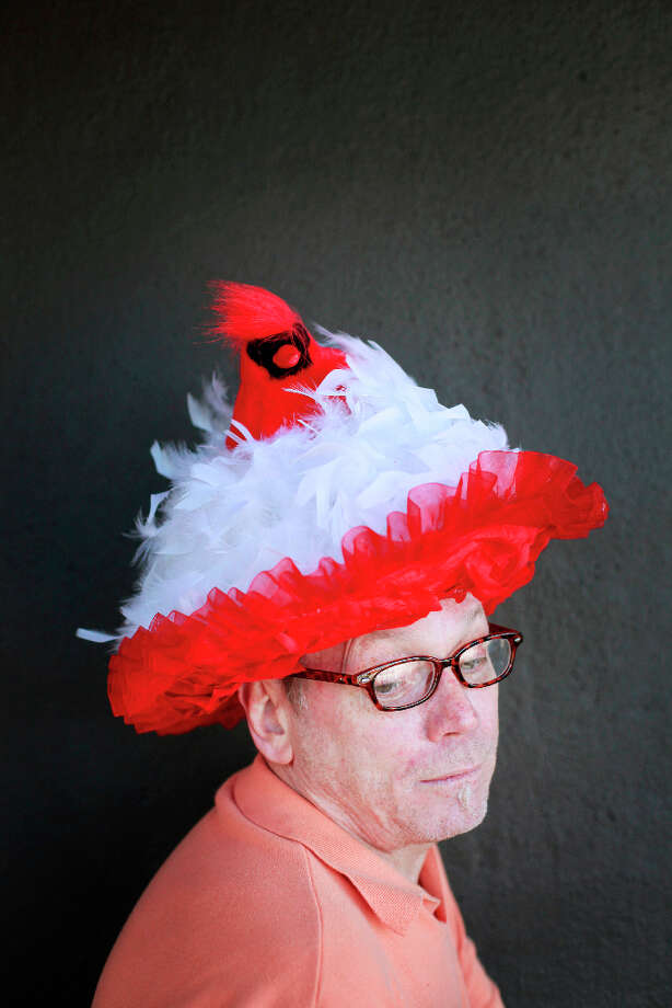 Easter bonnet designer mastermind extraordinaire Joe Mac models his red bird creation. Photo: Mike Kepka, The Chronicle / ONLINE_YES