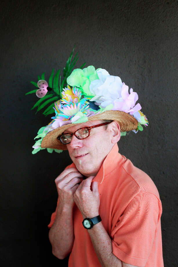 Easter bonnet designer mastermind extraordinaire Joe Mac models his traditional flowers creation. Photo: Mike Kepka, The Chronicle / ONLINE_YES