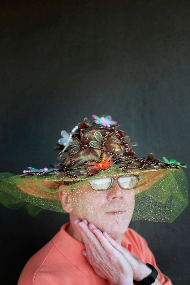 Easter bonnet designer mastermind extraordinaire Joe Mac models his dragonfly creation. Photo: Mike Kepka, The Chronicle / ONLINE_YES