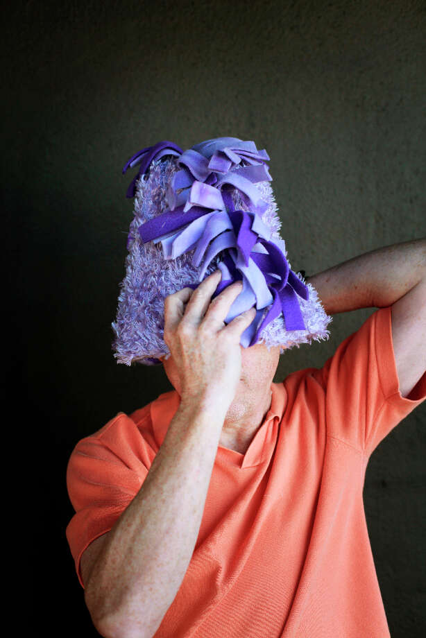Easter bonnet designer mastermind extraordinaire Joe Mac models his purple basket creation. Photo: Mike Kepka, The Chronicle / ONLINE_YES