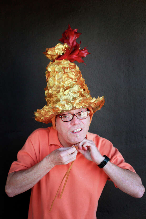 Easter bonnet designer mastermind extraordinaire Joe Mac models his golden topiary creation. Photo: Mike Kepka, The Chronicle / ONLINE_YES
