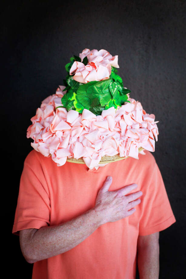 Easter bonnet designer mastermind extraordinaire Joe Mac models his flowering Audrey Hepburn creation. Photo: Mike Kepka, The Chronicle / ONLINE_YES