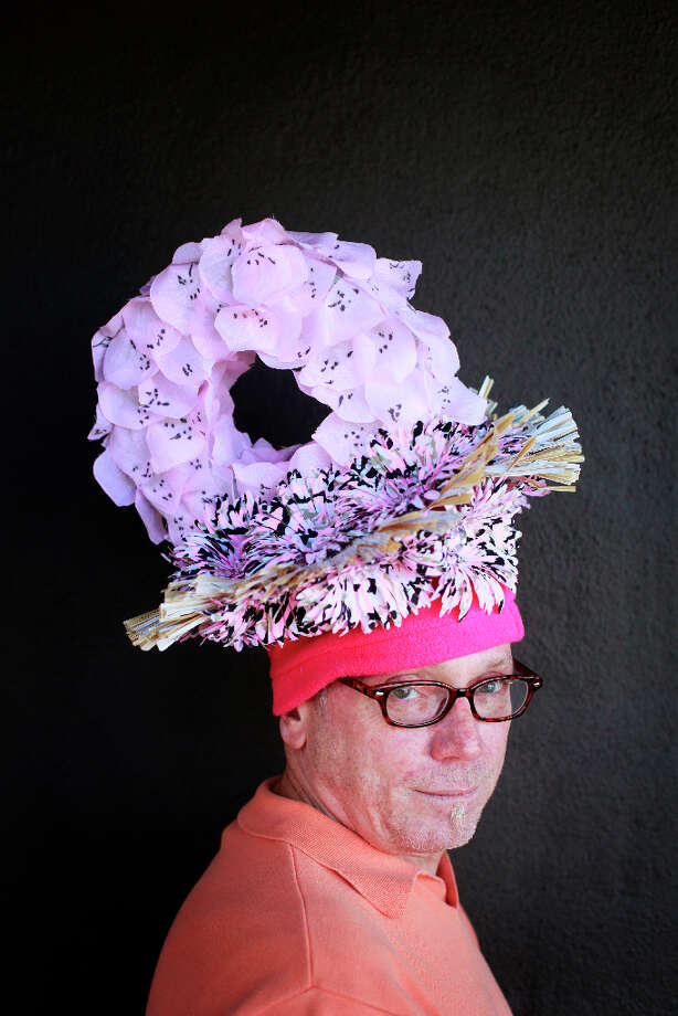 Easter bonnet designer mastermind extraordinaire Joe Mac models his sporty donut creation. Photo: Mike Kepka, The Chronicle / ONLINE_YES