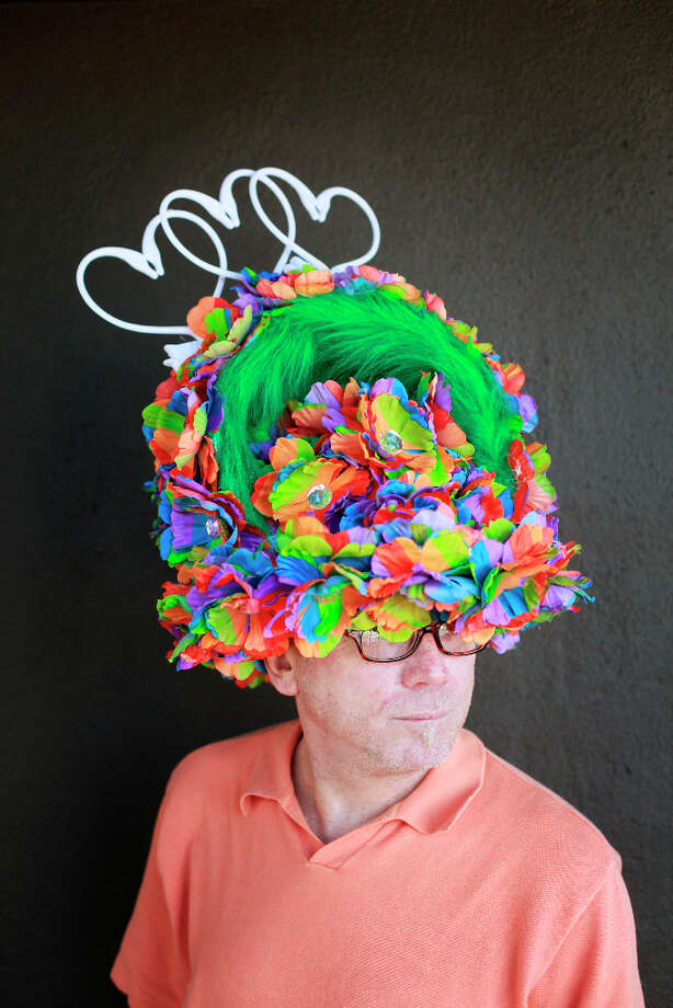 Easter bonnet designer mastermind extraordinaire Joe Mac models his rainbow and green fur creation. Photo: Mike Kepka, The Chronicle / ONLINE_YES