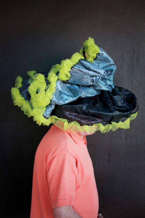 Easter bonnet designer mastermind extraordinaire Joe Mac models his Mr. Peanut creation. Photo: Mike Kepka, The Chronicle / ONLINE_YES