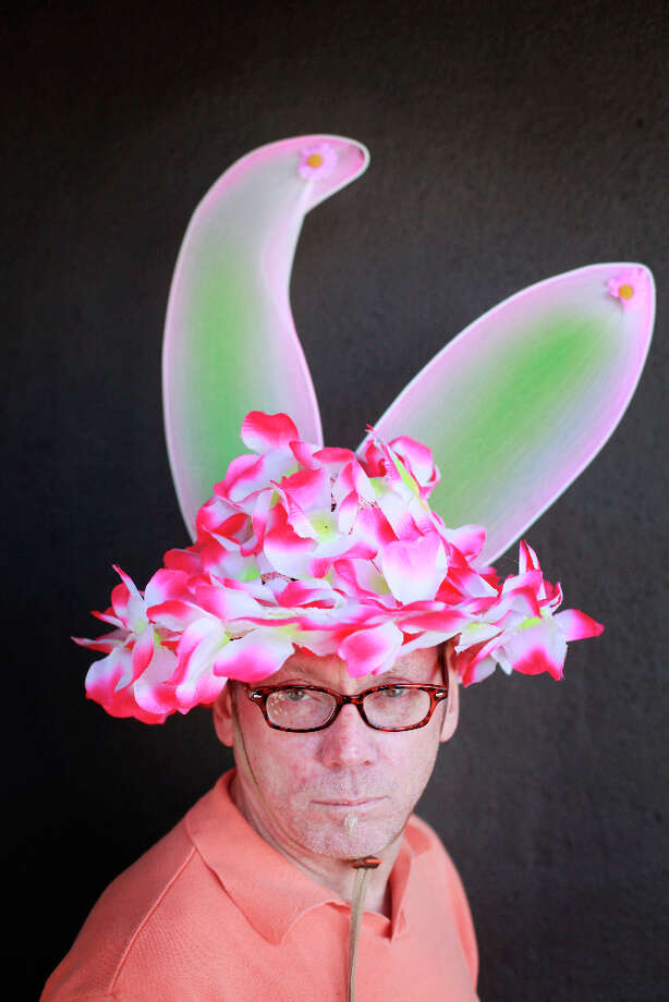 Easter bonnet designer mastermind extraordinaire Joe Mac models his giant flowers creation. Photo: Mike Kepka, The Chronicle / ONLINE_YES