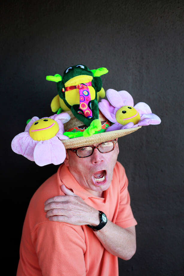 Easter bonnet designer mastermind extraordinaire Joe Mac models his frogs and flowers creation. Photo: Mike Kepka, The Chronicle / ONLINE_YES