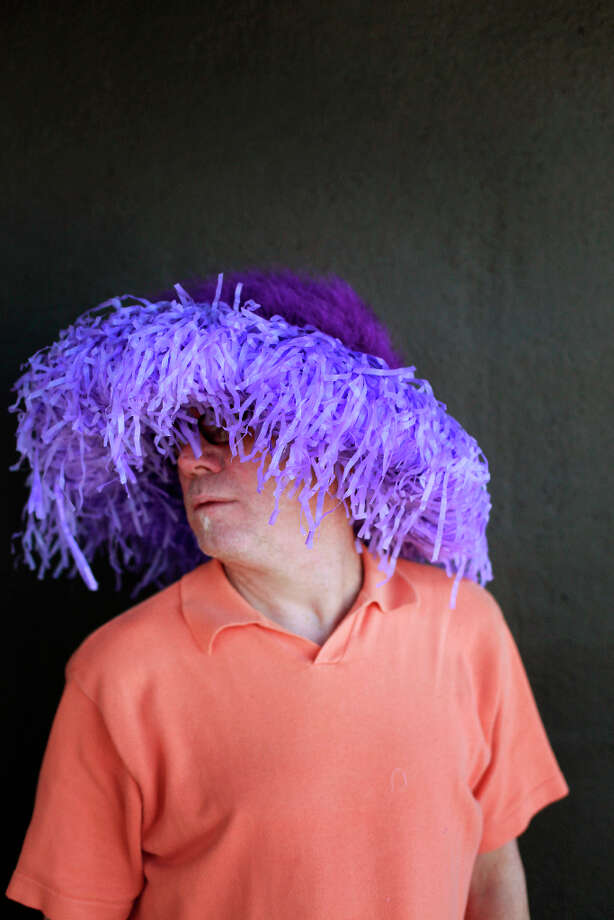 Easter bonnet designer mastermind extraordinaire Joe Mac models his purple blob creation. Photo: Mike Kepka, The Chronicle / ONLINE_YES