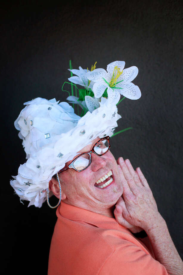 Easter bonnet designer mastermind extraordinaire Joe Mac models his jewels and lily creation. Photo: Mike Kepka, The Chronicle / ONLINE_YES