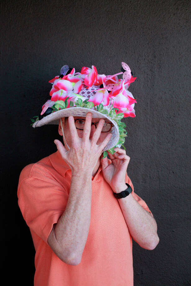 Easter bonnet designer mastermind extraordinaire Joe Mac models his faux orchids creation. Photo: Mike Kepka, The Chronicle / ONLINE_YES