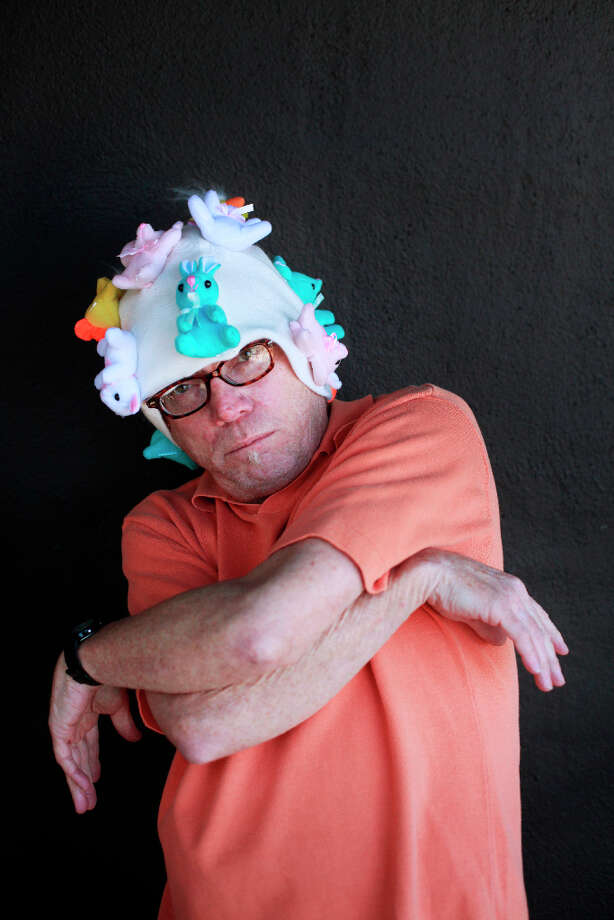 Easter bonnet designer mastermind extraordinaire Joe Mac models his Rapmaster bonnet creation. Photo: Mike Kepka, The Chronicle / ONLINE_YES