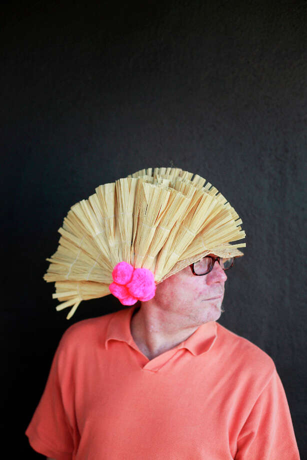 Easter bonnet designer mastermind extraordinaire Joe Mac models his Napoleon creation. Photo: Mike Kepka, The Chronicle / ONLINE_YES