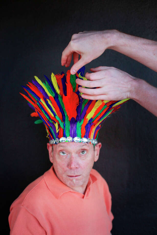 Easter bonnet designer mastermind extraordinaire Joe Mac models his feathered crown creation. Photo: Mike Kepka, The Chronicle / ONLINE_YES