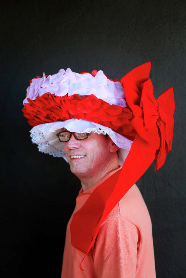 Easter bonnet designer mastermind extraordinaire Joe Mac models his flowers and bows creation. Photo: Mike Kepka, The Chronicle / ONLINE_YES