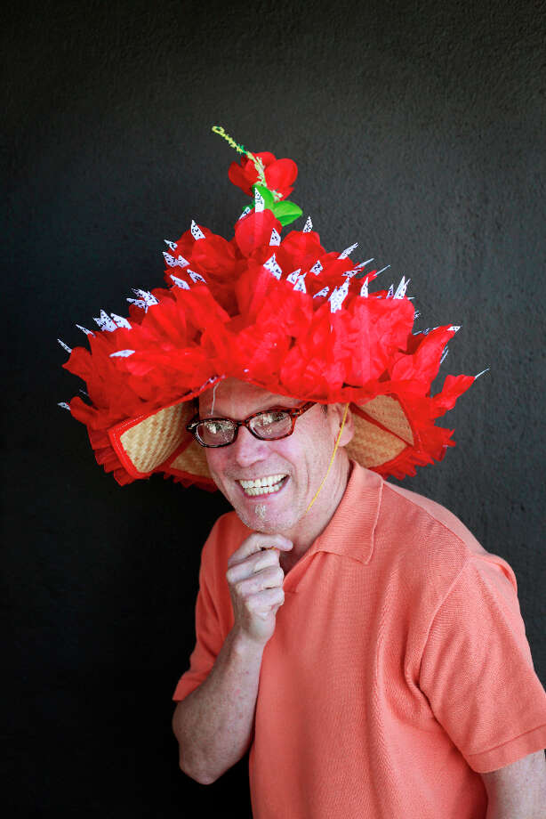 Easter bonnet designer mastermind extraordinaire Joe Mac models his rose petal and thorns creation. Photo: Mike Kepka, The Chronicle / ONLINE_YES