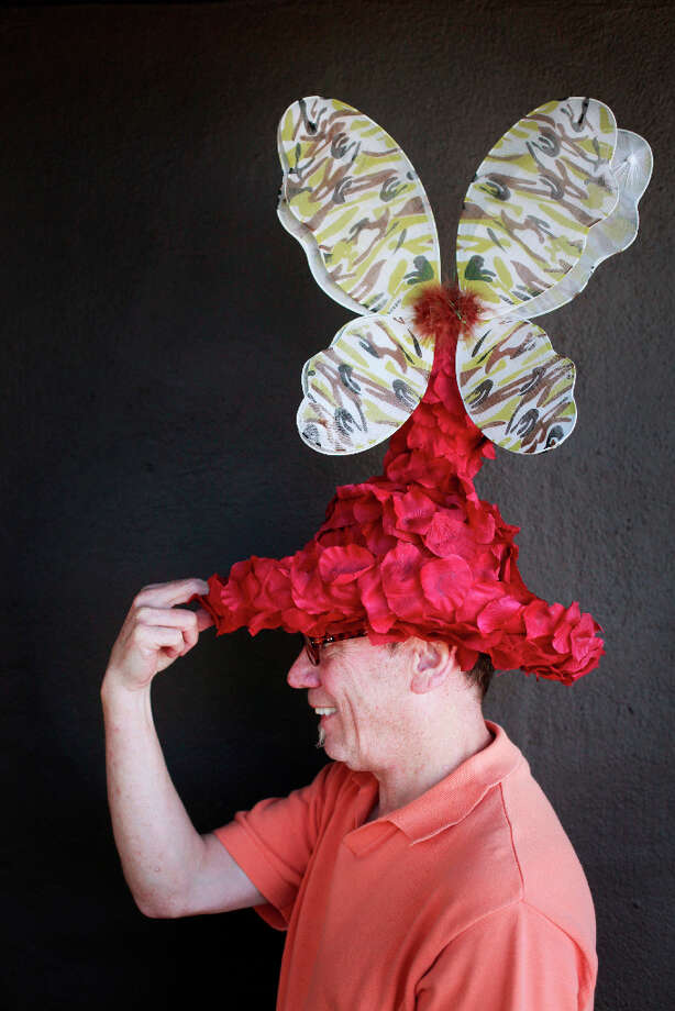 Easter bonnet designer mastermind extraordinaire Joe Mac models his butterfly topiary creation. Photo: Mike Kepka, The Chronicle / ONLINE_YES