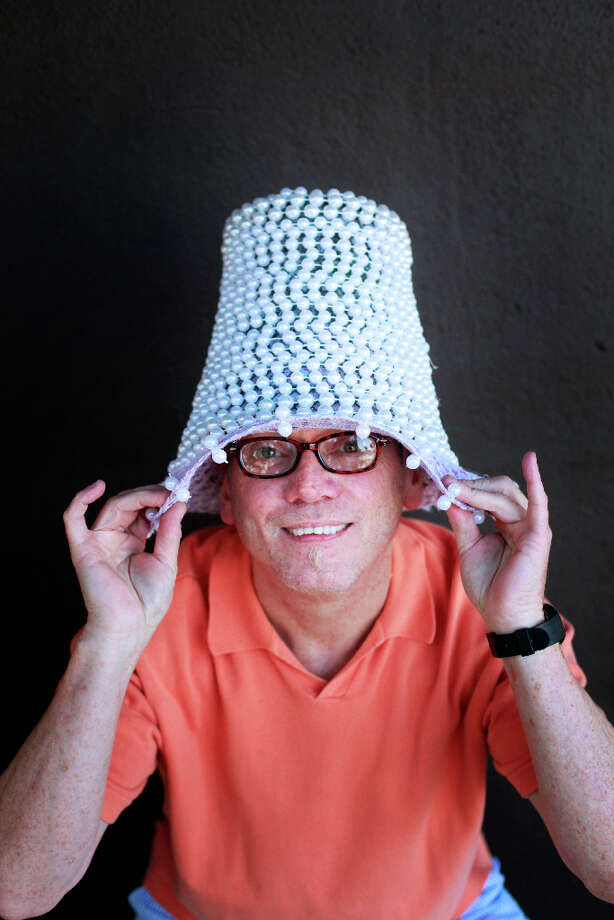 Easter bonnet designer mastermind extraordinaire Joe Mac models his pearl basket creation. Photo: Mike Kepka, The Chronicle / ONLINE_YES