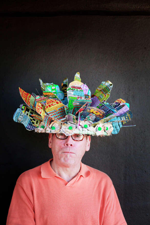 Easter bonnet designer mastermind extraordinaire Joe Mac models his lottery ticket creation. Photo: Mike Kepka, The Chronicle / ONLINE_YES