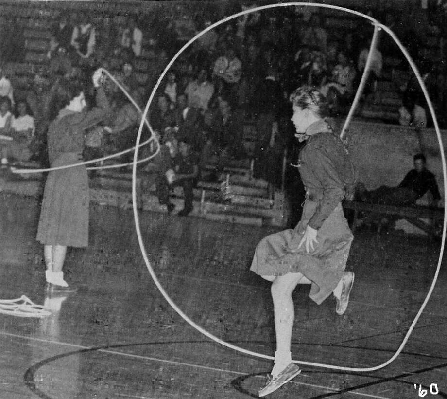 "Lassos perform a rope trick called ""Texas Skip"" during a basketball game halftime performance, 1960. Photo: Courtesy Photo,      Lasso Alumni Association"