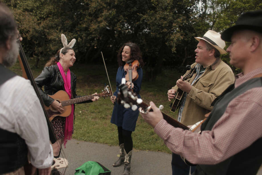 From left to right, Tom Drohan, Gayle Schmitt, Diana Greenberg, Ted Silverman and Greg Fletcher of Gayle Schmitt and the Toodala Ramblers warm up with her band before performing at the Eggstravaganza in Golden Gate Park on Saturday. Photo: James Tensuan, The Chronicle / ONLINE_YES