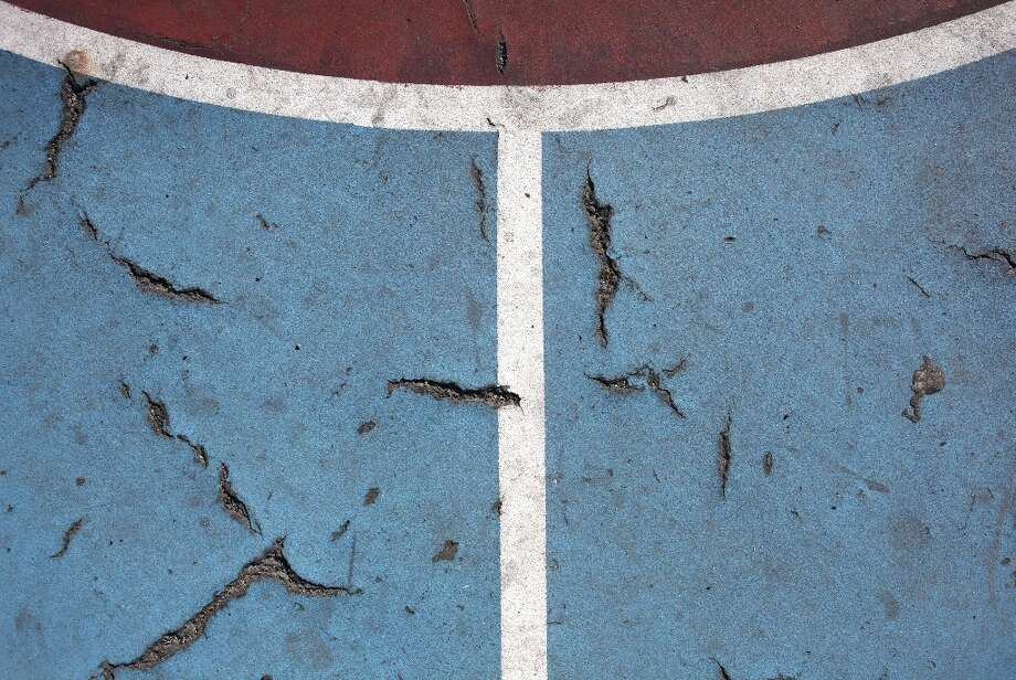 Detail of the cracks on the basketball court at Excelsior Playground on the Excelsior Heights hill on March 24, 2013 in San Francisco, Calif. Photo: Pete Kiehart, The Chronicle / ONLINE_YES