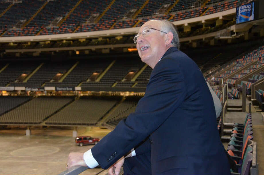 Outgoing Interior Secretary Ken Salazar surveys the inside of the Mercedes-Benz Superdome in New Orleans, as an offshore lease sale takes place inside a meeting room there.