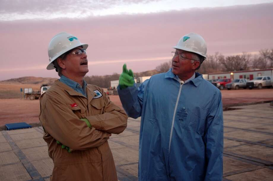 Sen. John Hoeven, R-N.D., and Interior Secretary Ken Salazar discuss North Dakota's oil boom after visiting a rig drilling wells in the Bakken formation for Newfield Exploration Co.