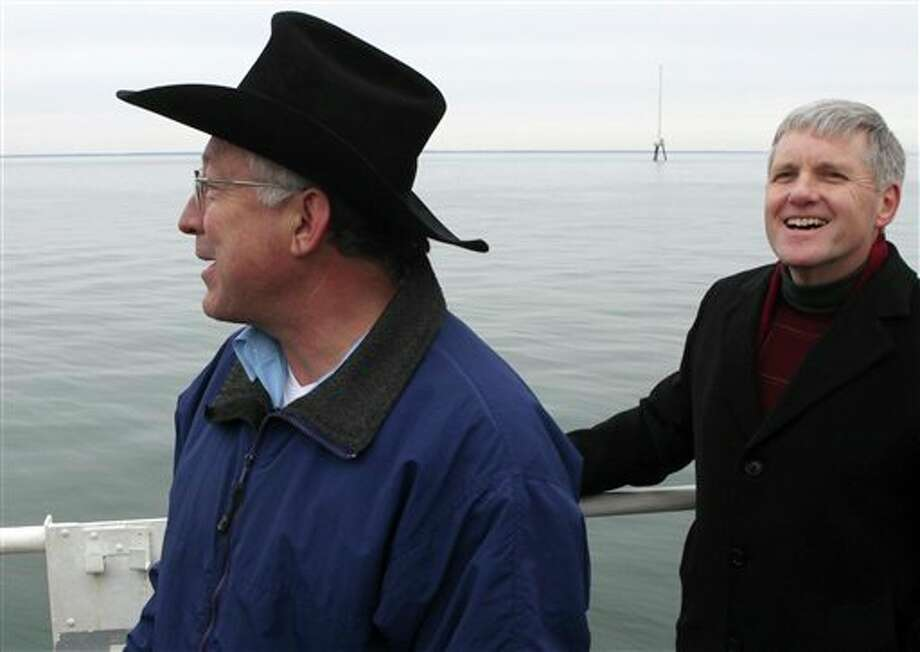 Interior Secretary Ken Salazar (left) and Deputy Secretary of the Interior David Hayes take in the view aboard the U.S. Coast Guard's Ida Lewis buoy tender in Nantucket Sound. The trip was held to assess the viability of the Cape Wind power project. Behind them is a 190-foot meteorological tower, part of the potential Cape Wind site. Photo: Julia Cumes, AP / AP2010