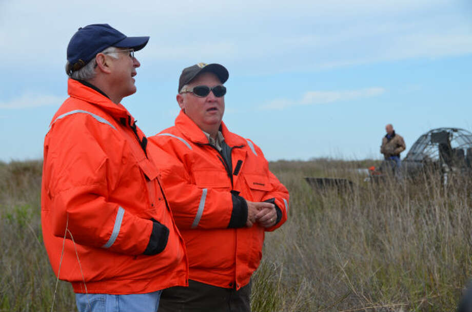 Interior Secretary Ken Salazar talks with James Harris, the senior biologist for the Southeast Louisiana Refuges Complex, during a visit to the Big Branch National Wildlife Refuge on Wednesday.