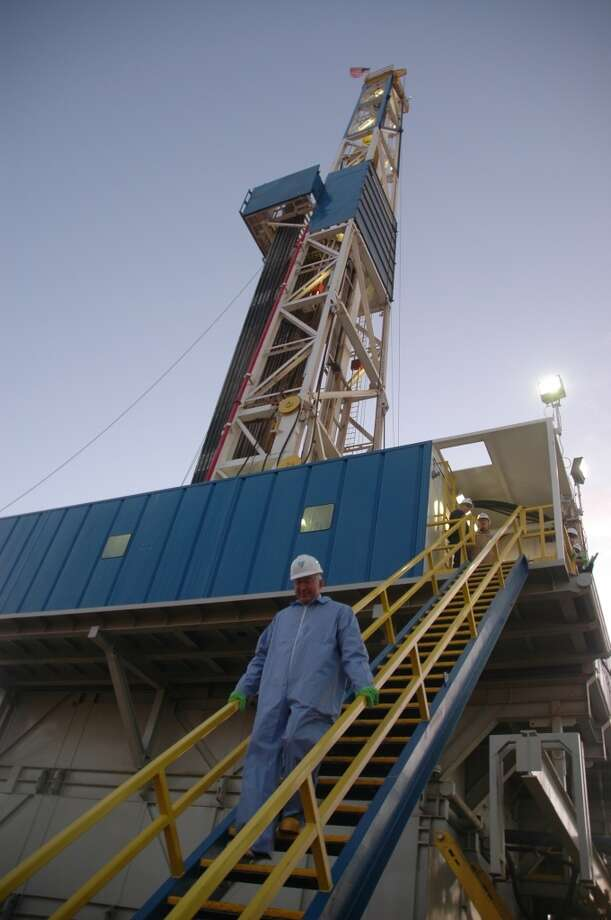 Interior Secretary Ken Salazar climbs stairs from a rig drilling wells for Newfield Exploration Co., in McKenzie County, N.D. during a visit to the state on April 2.