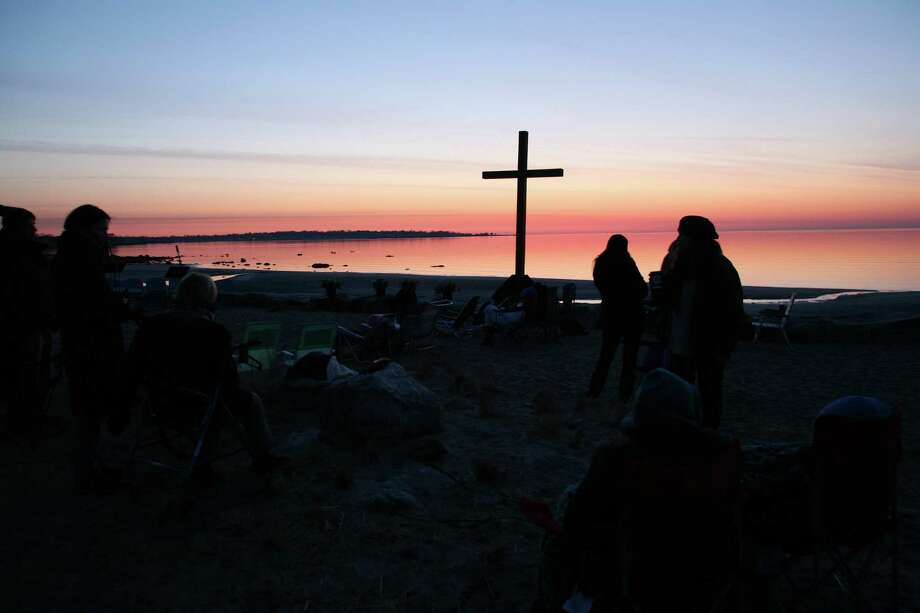 The First Congregational Church of Greenwich held its' annual sunrise service at Greenwich Point Easter, March 31, 2013. Photo: David Ames