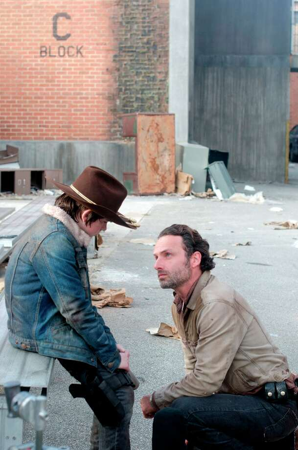 Carl Grimes (Chandler Riggs) and Rick Grimes (Andrew Lincoln) - The Walking Dead - Season 3, Episode 16 - Photo Credit: Gene Page/AMC Photo: Gene Page