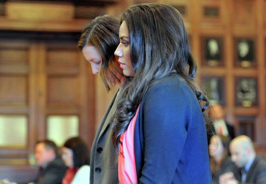 Alexis Wright appears with her attorney, Sarah Churchill, Friday, March 29, 2013 in Cumberland County Court, in Portland, Maine. Wright, a dance instructor accused of using her Zumba fitness studio as a front for prostitution pleaded guilty Friday to 20 counts in a scandal that captivated a quiet seaside town. Photo: AP