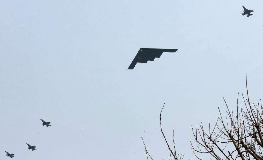 U.S. Air Force B-2 stealth bomber flies over near Osan U.S. Air Base in Pyeongtaek, south of Seoul, South Korea, Thursday, March 28, 2013. A day after shutting down a key military hotline, Pyongyang instead used indirect communications with Seoul to allow South Koreans to cross the heavily armed border and work at a factory complex that is the last major symbol of inter-Korean cooperation. (AP Photo/Shin Young-keun, Yonhap) KOREA OUT Photo: AP