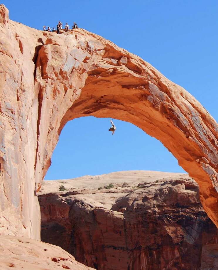 This photo taken Nov. 4, 2012 shows a person swinging from the Corona Arch near Moab, Utah. A 22-year-old man was killed Sunday, March 24, 2013 trying to swing through the opening of the 110-foot, 33-meter-tall, sandstone arch in a stunt made so popular on YouTube that state authorities recently banned the daredevil activity by commercial outfitters. Photo: AP