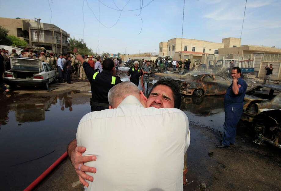 An Iraqi man is comforted at the scene of a car bomb attack in Baghdad, Iraq, Friday, March 29, 2013. A parked car bomb exploded near the al-Mahdi mosque in the northeastern Binook neighborhood as worshippers were leaving Friday prayers, killing and wounding several, just one of a string of bombings targeting Shiite mosques on Friday, killing and wounding dozens of people, police said. Photo: AP