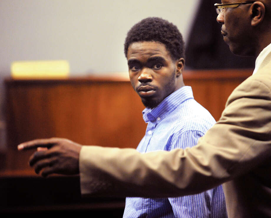 A Glynn County Sheriff's Deputy directs 17 year-old De Marquise Elkins out of the courtroom in the Glynn County Courthouse in Brunswick, Ga.  after Elkin's first appearance hearing in Magistrate Court Monday, March 25, 2013.  Elkins and a 15 year-old were arrested Friday, March 23 and charged by warrant in the shooting death of 13-month-old  Antonio Santiago. Photo: AP