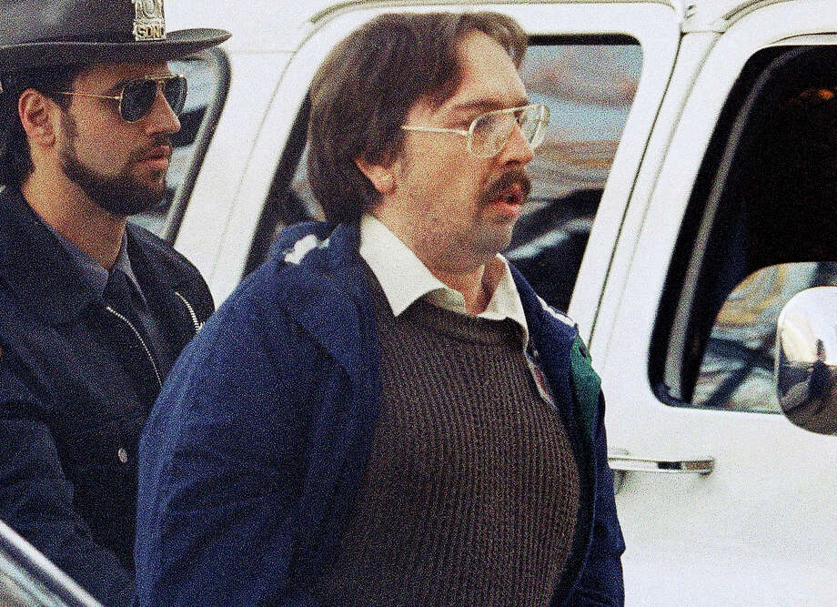 In this Dec. 17, 1993 file photo, Joel Rifkin, right, is led to the Nassau County Courthouse in Mineola, N.Y., for a suppression hearing.  New Jersey State Police said Wednesday, March 27, 2013, that 25-year-old Heidi Balch likely was the first victim of Rifkin, who is in prison in New York after admitting he killed 17 women in the early 1990s. Balch's severed head was found on a golf course in Hopewell Township, near Trenton, N.J., in March 1989. Photo: AP