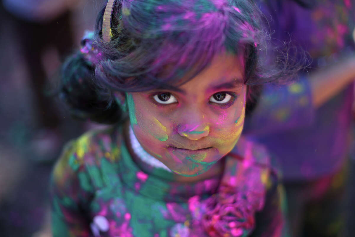 Adithi Ullas, 4, is covered with gulaal during a celebration of Holi, the Hindu festival of colors on Saturday, March 30, 2013 at the Sanatan Dharma Temple & Cultural Center in Maple Valley. The annual cultural and religious event is a time for Hindus to enjoy spring's abundant colors and say farewell to winter.