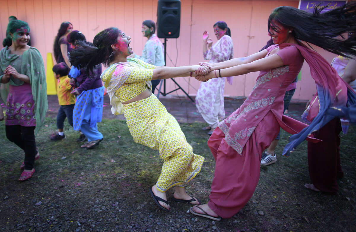 Bhavya Kumar, left, and Priyonka Golen dance during a celebration of Holi, the Hindu festival of colors on Saturday, March 30, 2013 at the Sanatan Dharma Temple & Cultural Center in Maple Valley. The annual cultural and religious event is a time for Hindus to enjoy spring's abundant colors and say farewell to winter.