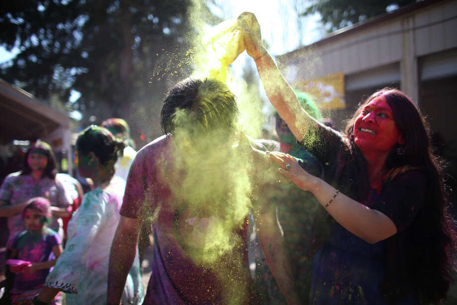 A participant dumps color on the head of another participant during a celebration of Holi, the Hindu festival of colors on Saturday, March 30, 2013 at the Sanatan Dharma Temple & Cultural Center in Maple Valley. The annual cultural and religious event is a time for Hindus to enjoy spring's abundant colors and say farewell to winter. Photo: JOSHUA TRUJILLO / SEATTLEPI.COM