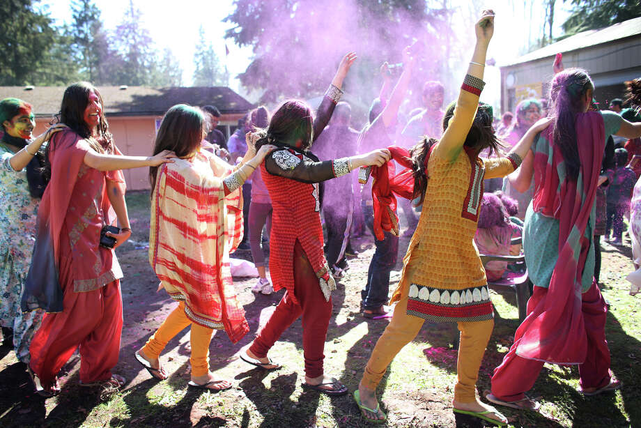 People dance during a celebration of Holi, the Hindu festival of colors on Saturday, March 30, 2013 at the Sanatan Dharma Temple & Cultural Center in Maple Valley. The annual cultural and religious event is a time for Hindus to enjoy spring's abundant colors and say farewell to winter. Photo: JOSHUA TRUJILLO / SEATTLEPI.COM