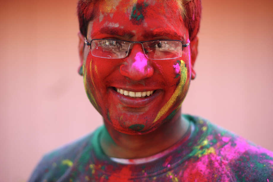 Sunny Gakhar shows his colorful face during a celebration of Holi, the Hindu festival of colors on Saturday, March 30, 2013 at the Sanatan Dharma Temple & Cultural Center in Maple Valley. The annual cultural and religious event is a time for Hindus to enjoy spring's abundant colors and say farewell to winter. Photo: JOSHUA TRUJILLO / SEATTLEPI.COM