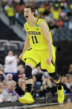 Michigan 79, Florida 59Michigan guard Nik Stauskas reacts after making a 3-point shot against Florida during the first half of a regional final game in the NCAA college basketball tournament, Sunday, March 31, 2013, in Arlington, Texas. (AP Photo/David J. Phillip) Photo: David J. Phillip, Associated Press / AP