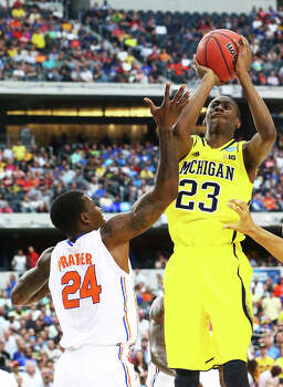 ARLINGTON, TX - MARCH 31:  Caris LeVert #23 of the Michigan Wolverines shoots over Casey Prather #24 of the Florida Gators in the first half during the South Regional Round Final of the 2013 NCAA Men's Basketball Tournament at Dallas Cowboys Stadium on March 31, 2013 in Arlington, Texas. Photo: Ronald Martinez, Getty Images / 2013 Getty Images