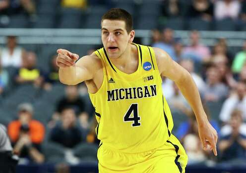 ARLINGTON, TX - MARCH 31:  Mitch McGary #4 of the Michigan Wolverines reacts in the first half against the Florida Gators during the South Regional Round Final of the 2013 NCAA Men's Basketball Tournament at Dallas Cowboys Stadium on March 31, 2013 in Arlington, Texas. Photo: Tom Pennington, Getty Images / 2013 Getty Images
